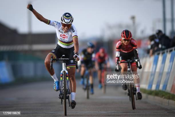 Dutch Ceylin Del Carmen Alvarado celebrates as she crosses the finish line of the women's elite race at the Ethias Cross in Leuven on November 14,...