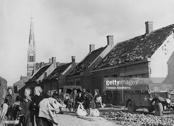 Dutch civilians evacuate the village of Wagenberg Netherlands November 1944 The village is only 400 yards from the German lines at Hooge Zwaluwe