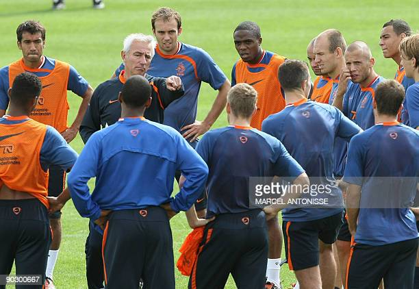 Dutch coach Bert van Marwijk talks to his players on September 2 2009 during a training session of the Dutch team prior their friendly match against...
