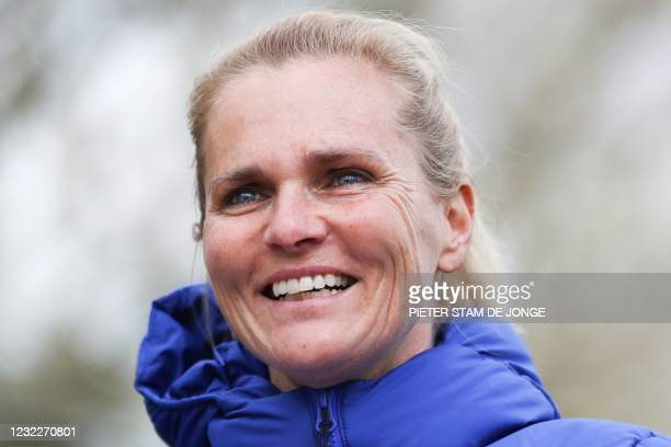 Dutch coach of The Netherlands' national women football team Sarina Wiegman smiles during a training session at the KNVB Campus in Zeist, on April 12...