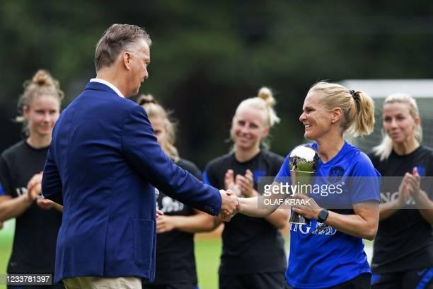 Dutch coach of The Netherlands' national women football team Sarina Wiegman receives the Best FIFA Women's Coach 2020 award from Dutch football...