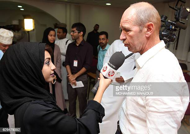 Dutch coach Peter Tim Verbeek known as Pim Verbeek answers a reporters question during a press conference after signing a contract to coach the Omani...