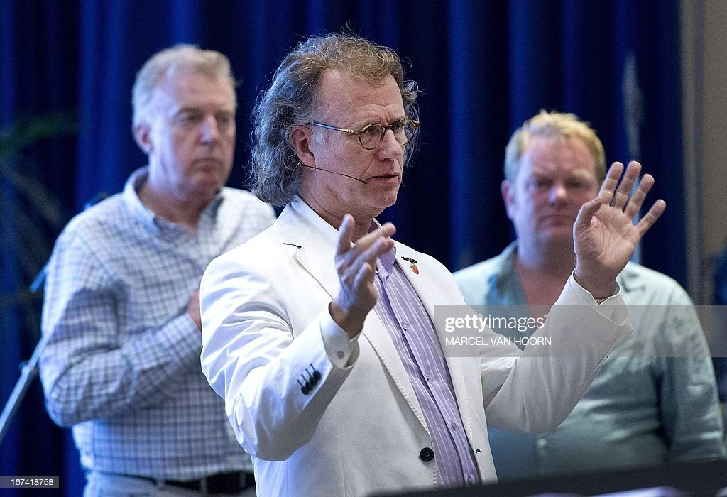 Dutch conductor Andre Rieu (C), actor Martijn Fischer (R) and comedian Andre van Duin rehearse on April 25, 2013 in Rieu's studio in Maastricht. Rieu will perform with the Johann Strauss orchestra on April 30 at the Kings Ball in Amsterdam after the coronation of Prince Willem-Alexander. AFP PHOTO / ANP / KIPPA MARCEL HOORN - netherlands out -