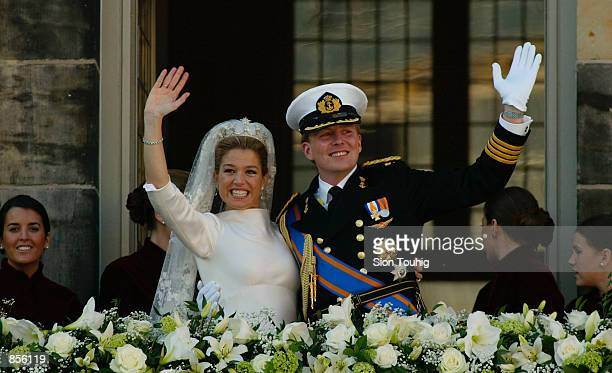 Dutch Crown Prince Willem Alexander and his new bride Crown Princess Maxima Zorreguieta wave to the crowd after their wedding February 2 2002 on the...