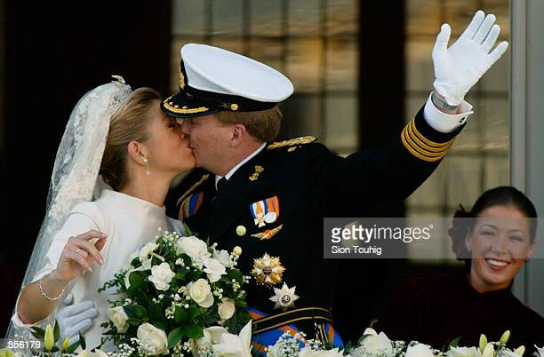 Dutch Crown Prince Willem Alexander and his new bride Crown Princess Maxima Zorreguieta kiss after their wedding February 2 2002 on the balcony of...