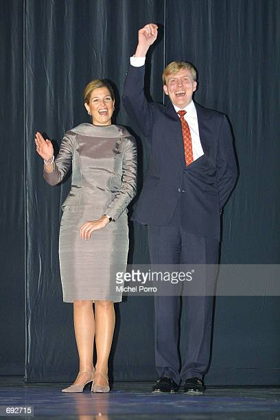 Dutch Crown Prince Willem Alexander and Maxima Zorreguieta, fiancee of Prince William, wave to the audience as they stand on stage during a ballet...