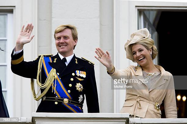 Dutch Crown Prince Willem Alexander and Princess Maxima of the Dutch Royal Family wave from the Noordeinde Palace balcony during Prince's Day...