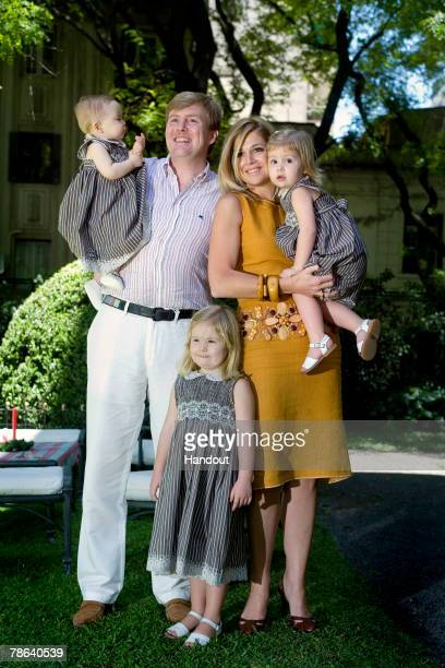 Dutch Crown Prince Willem Alexander holds Princess Ariane and Princess Maxima holds Princess Alexia with Princess Amalia 2 during a winter holiday...