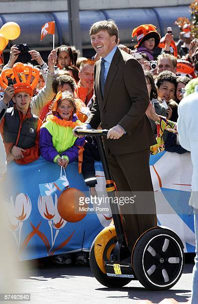 Dutch Crown Prince Willem Alexander wheels around on a batterypowered 'electronic pedestrian' called Segway during the traditional Queens Day...