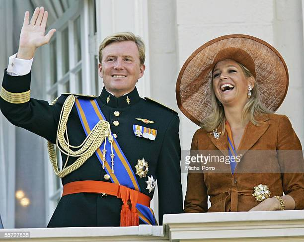 Dutch Crown Prince WillemAlexander and his wife Princess Maxima wave to the crowd after the Parliamentary Budget Presentation at The Hague on...