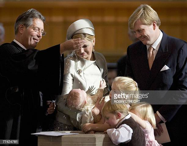Dutch Crown Prince WillemAlexander and Princess Maxima hold their youngest daughter Princess Ariane during her baptism ceremony by Reverend Deodaat...
