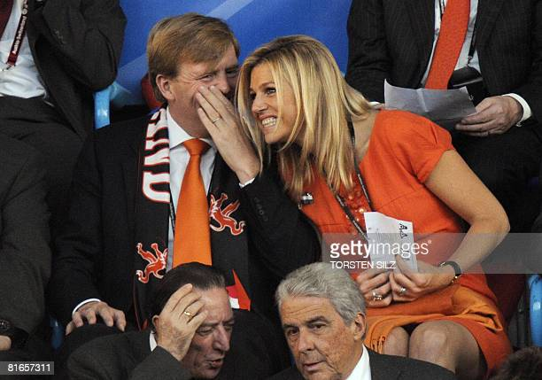 Dutch Crown Prince WillemAlexander speaks to his wife Princess Maxima as they sit in the stands a few moments before the Euro 2008 Championships...