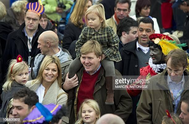 Dutch Crownprince Prins Willem Alexander Princess Maxima and their daughters Princesses Amalia Ariane and Alexia await the arrival of Saint Nicholas...