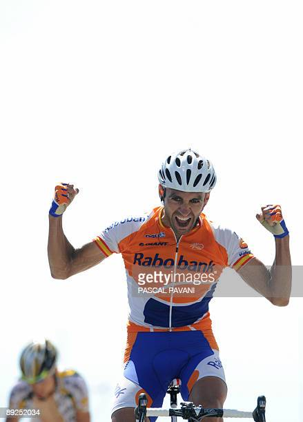 Dutch cycling team Rabobank 's Juan Manuel Garate of Spain jubilates on the finish line as winning ahead of US cycling Team Columbia-High Road 's...