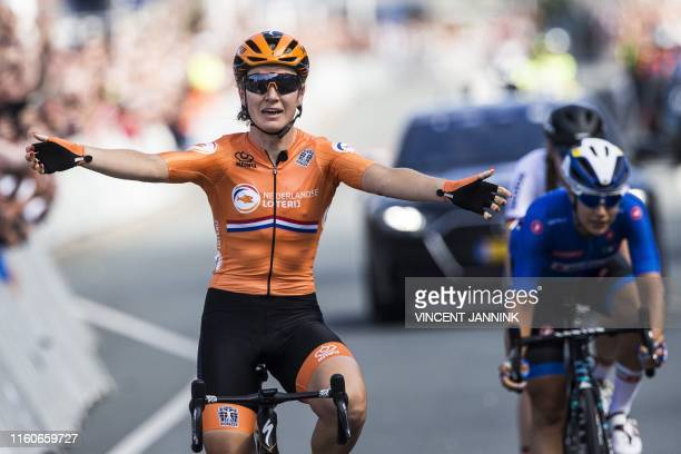 Dutch cyclist Amy Pieters celebrates as she crosses the finish line in front of second-placed Italy's Elena Cecchini , and wins the women's Elite...