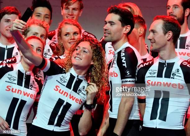 Dutch cyclist Floortje Mackaij takes a selfie with Dutch cyclist Tom Dumoulin during the 2018 Sunweb cycling team's official presentation on January...