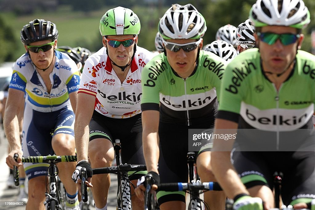 Dutch cyclist Lars Boom (2nd L) of the Belkin teampro cycling team rides with teammates during the sixth stage of the Eneco Tour cycling race, from Riemst to La Redoute, in Aywaille, on August 17, 2013. The event, formerly known as the Tour of Benelux, takes the peloton through Belgium and the Netherlands over seven stages and 1,080km.
