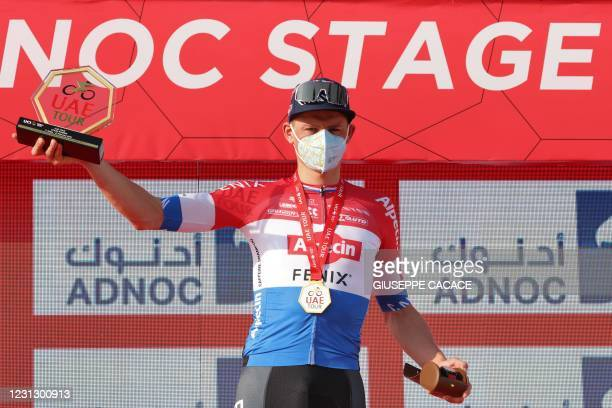 Dutch cyclist Mathieu van der Poel of Team AlpecinFenix celebrates on the podium after winning the first stage of the UAE Cycling Tour from al-Dhafra...