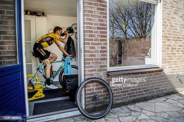 Dutch cyclist Mike Teunissen of team Jumbo Visma drinks as he rides on the conveyor belt in his home in Rosmalen, The Netherlands, on April 5, 2020...