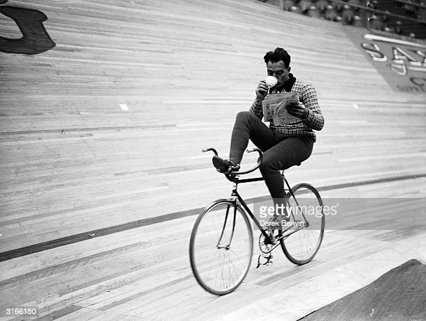 German cyclist Piet Van Kempen circles the track at Wembley during a six day cycling event Most competitors have covered 1000 miles