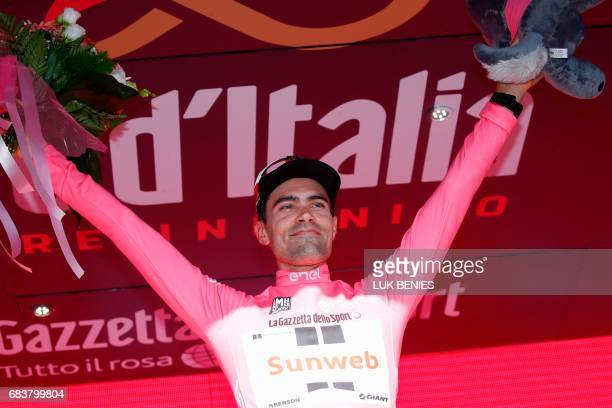 Dutch cyclist Tom Dumoulin from Team Sunweb celebrates the pink jersey of the overall leader on the podium after winning the 10th stage from Foligno...