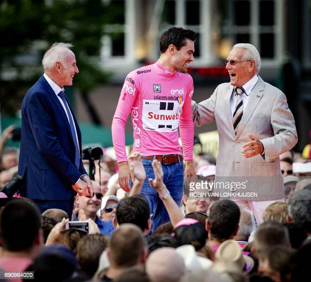 Dutch Cyclist Tom Dumoulin is greeted by veteran compatriot cyclists Joop Zoetemelk Jan Janssen during a ceremony in Maastricht on May 31 2017...