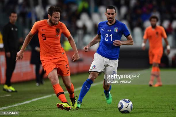 Dutch defender Daley Blind vies with Italian defender Davide Zappacosta during the international friendly football match between Italy and the...