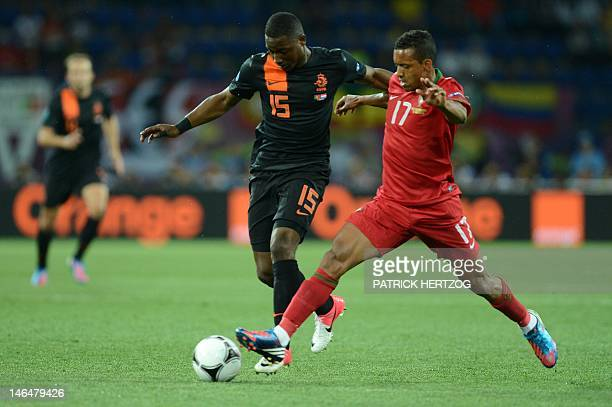 Dutch defender Jetro Willems vies with Portuguese midfielder Nani during the Euro 2012 football championships match Portugal vs Netherlands on June...