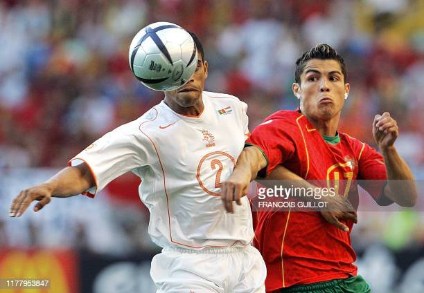 Dutch defender Michael Reiziger vies with Portuguese forward Cristiano Ronaldo, 30 June 2004 at the Alvalade stadium in Lisbon, during the Euro 2004...