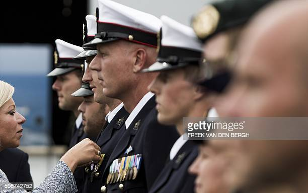 Dutch Defense Minister Jeanine Hennis-Plasschaert awards with medals Marine Corps special security members during the 39th edition of the World Port...