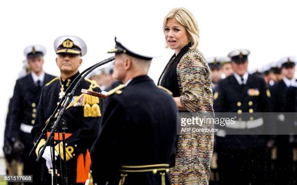 Dutch Defense Minister Jeanine HennisPlasschaert hands out a royal award to vice admiral Rob Kramer who will succeed to Rob Verkerk as Commander of...