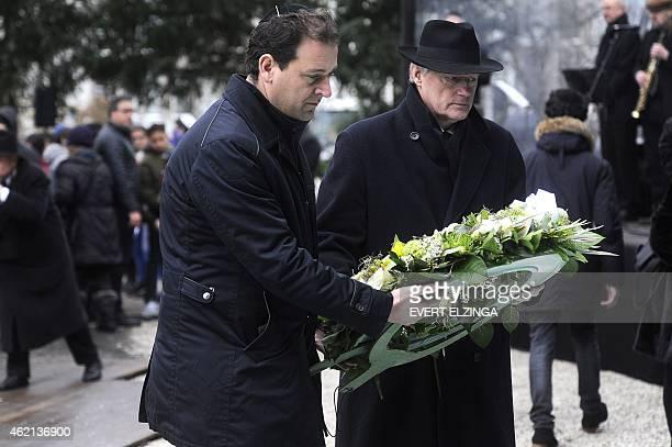 Dutch Deputy Prime Minister Lodewijk Asscher and state secretary Martin van Rijn place a wreath at the Auschwitz monument in the Wertheimpark in...