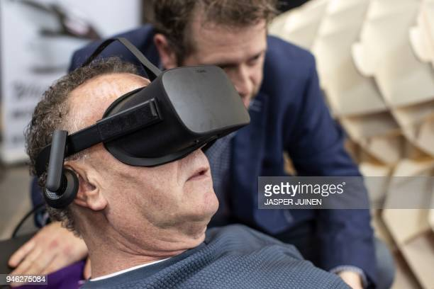 Dutch designer Alexander Bannink explains how the Sarco euthanasia pod works as a man experiences sitting in the device by wearing virtual reality...