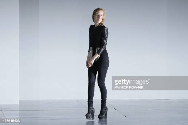 Dutch designer Iris Van Herpen acknowledges the audience at the end of her 2014/2015 Autumn/Winter readytowear collection fashion show on March 4...
