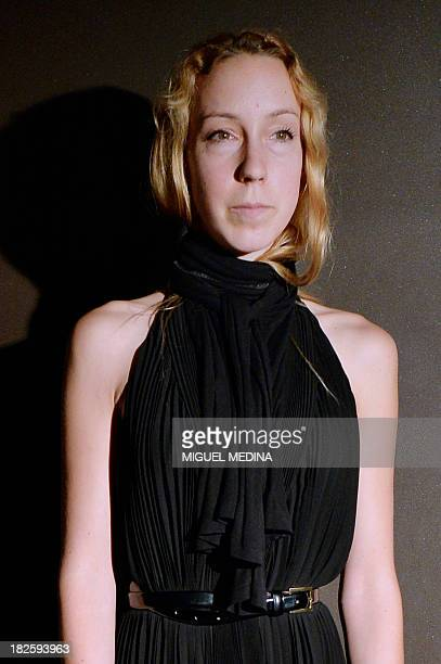 Dutch designer Iris Van Herpen poses at the end of her 2014 Spring/Summer readytowear collection fashion show on October 1 2013 in Paris AFP PHOTO /...