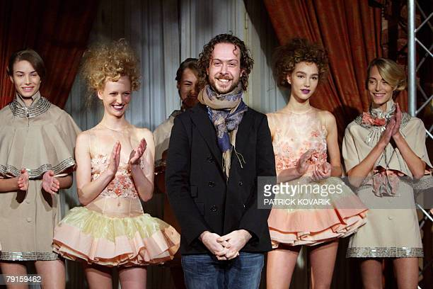 Dutch designer JanTaminiau acknowledges the public at the end of Spring/Summer 2008 Haute Couture collection show in Paris, 22 January 2008. AFP...