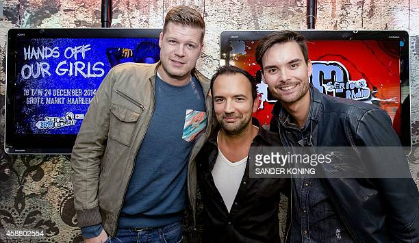 Dutch dj's Coen Swijnenberg Gerard Ekdom and Domien Verschuuren pose in Hilversum on November 11 2014 The djs will lock themselves up voluntarily for...