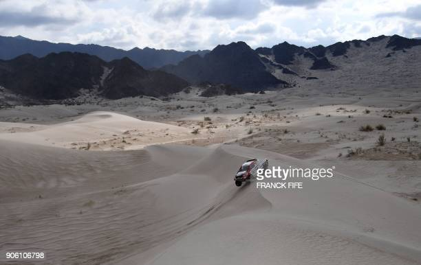 Dutch driver Bernhard ten Brinke with his codriver Michel Perin of France steers his Toyota during the Stage 11 of the 2018 Dakar Rally between Belen...