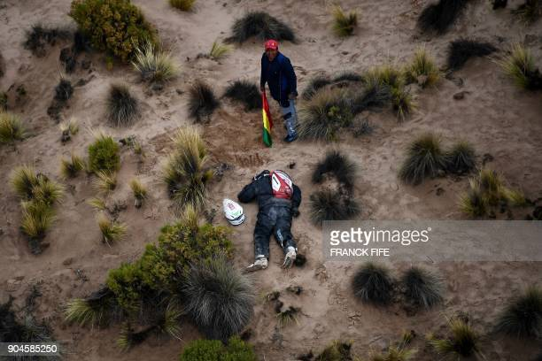 TOPSHOT Dutch driver Guillaume Martens takes a nap during Stage 7 of the 2018 Dakar Rally between La Paz and Uyuni Bolivia on January 13 2018...