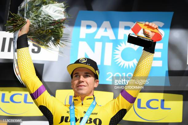 Dutch Dylan Groenewegen of Team JumboVisma celebrates on the podium after winning the first stage of the 77th edition of ParisNice cycling race5km...