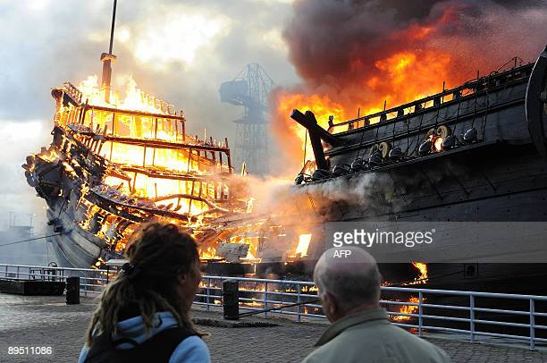 A Dutch East India Company replica of the Prince Willem vessel burns in the historical museum harbor in Den Helder on July 30 2009 The replica was...