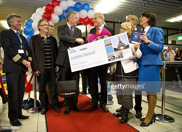 Dutch Edith Smits and her husband Theo are welcomed on December 20, 2012 by the chief executive of Schiphol airport, Jos Nijhuis , and the president...