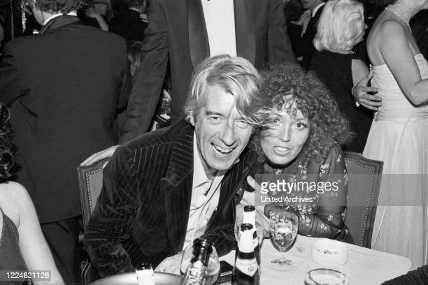 Dutch entertainer and actor Rudi Carrell with his wife Anke Bobbert at the Deutscher Filmball on January 15th 1979 at Munich, Germany, 1970s.