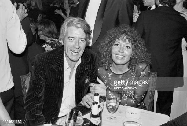 Dutch entertainer and actor Rudi Carrell with his wife Anke Bobbert at the Deutscher Filmball on January 15th 1979 at Munich Germany 1970s