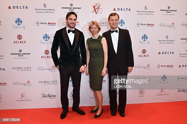 Dutch entrepreneur and author Peter Stas and his wife Aletta StasBax and Scottish international rugby player Thom Evans pose as they arrive at the...
