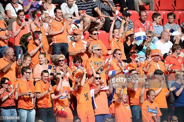 Dutch fans cheers their team during the UEFA Women's EURO 2013 group B football match Norway and the Netherlands in Kalmar Sweden on July 14 2013 AFP...