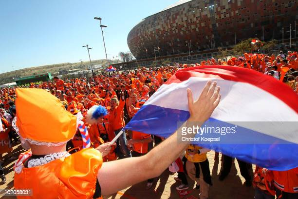 Dutch fans enjoy the atmosphere ahead of the 2010 FIFA World Cup Group E match between Netherlands and Denmark at Soccer City Stadium on June 14 2010...