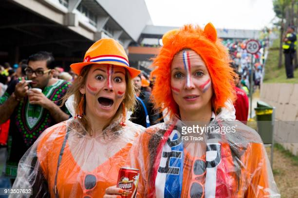 dutch fans going to match in the world cup 2014 - world sports championship stock pictures, royalty-free photos & images
