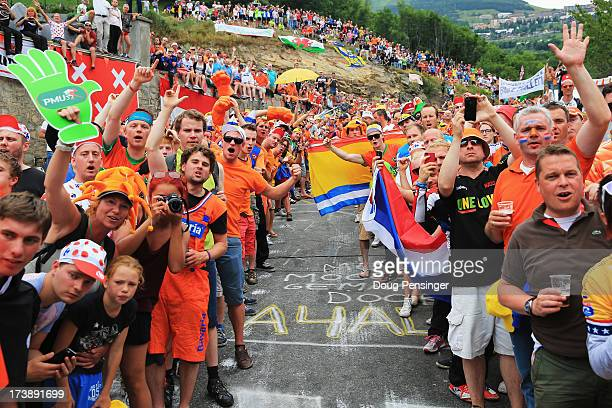 Dutch fans line the road to the top of the Alpe d'Huez during stage eighteen of the 2013 Tour de France a 1725KM road stage from Gap to l'Alpe d'Huez...