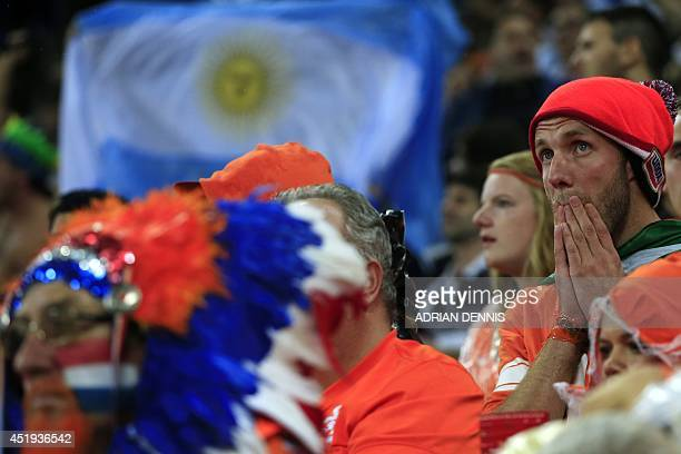 Dutch fans react during the semifinal football match between Netherlands and Argentina of the FIFA World Cup at The Corinthians Arena in Sao Paulo on...